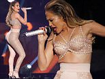 MIAMI, FL - APRIL 30:  Jennifer Lopez performs musical tribute to Selena while performing with Los Dinos onstage at the 2015 Billboard Latin Music Awards presented bu State Farm on Telemundo at Bank United Center on April 30, 2015 in Miami, Florida.  (Photo by Rodrigo Varela/Getty Images)