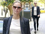 136573, Karolina Kurkova returns to the Carlyle Hotel after shopping on Madison Avenue in NYC. New York, New York - Sunday May 02, 2015. Photograph: © PacificCoastNews. Los Angeles Office: +1 310.822.0419 sales@pacificcoastnews.com FEE MUST BE AGREED PRIOR TO USAGE