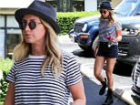 UK CLIENTS MUST CREDIT: AKM-GSI ONLY\nEXCLUSIVE: Ashley Tisdale shows off her toned legs as she stops by Earth Bar in West Hollywood for a quick smoothie run.\n\nPictured: Ashley Tisdale\nRef: SPL1015441  020515   EXCLUSIVE\nPicture by: AKM-GSI / Splash News\n\n