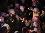 In this Tuesday, April 15, 2015 photo, Yazidis gather at the holy shrine of Lalish, 57 kilometers (35 miles) north of militant-held Mosul, Iraq, as thousands gather to mark the New Year, their first since Islamic State militants swept through the area last summer. Yazidis, a centuries-old religion derived from Zoroastrianism, Christianity and Islam, believe that the occasion marks the creation of the earth, also the day that God created the holy shrine in Lalish. (AP Photo/Seivan M. Salim)