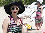 2.MAY.2014 - KONA - HAWAII\n*STRICTLY AVAILABLE FOR UK AND GERMANY USE ONLY*\nMAD MEN STAR JANUARY JONES GOES FOR A DIP IN THE BEAUTIFUL OCEAN OF HAWAII. THE US ACTRESS SPENT THE DAY PLAYING WITH HER SON XANDER AND HANGING OUT WITH HER PARENTS\nBYLINE MUST READ : XPOSUREPHOTOS.COM\n***UK CLIENTS - PICTURES CONTAINING CHILDREN PLEASE PIXELATE FACE PRIOR TO PUBLICATION ***\n*UK CLIENTS MUST CALL PRIOR TO TV OR ONLINE USAGE PLEASE TELEPHONE 0208 344 2007*\n