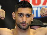 """File photo dated 26/04/2013 of Amir Khan. PRESS ASSOCIATION Photo. Issue date: Tuesday March 31, 2015. Amir Khan wants a """"winner takes all"""" showdown with British rival Kell Brook - but has told the IBF welterweight champion he will have to wait. See PA story BOXING Khan. Photo credit should read Martin Rickett/PA Wire."""