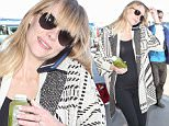 Picture Shows: Jaime King  May 02, 2015\n \n Pregnant actress, Jaime King, and family departing on a flight at LAX airport in Los Angeles, California. Jaime was drinking a healthy green juice to make sure she gets all her vitamins during her pregnancy.\n \n Non-Exclusive\n UK RIGHTS ONLY\n \n Pictures by : FameFlynet UK © 2015\n Tel : +44 (0)20 3551 5049\n Email : info@fameflynet.uk.com