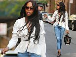 May 3, 2015: Naomi Campbell wears an airy white blouse in New York City.\nMandatory Credit: INFphoto.com Ref.: infusny-198