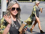 Picture Shows: Hilary Duff  May 03, 2015    Singer and actress Hilary Duff looks boho chic as she stops by Starbucks in Studio City, California. Hilary, who has been busy working on her new album, recently revealed that she has been using the dating app Tinder to meet new love interests.     Exclusive All Rounder  UK RIGHTS ONLY    Pictures by : FameFlynet UK © 2015  Tel : +44 (0)20 3551 5049  Email : info@fameflynet.uk.com