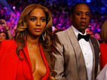 Power couple: Beyoncé and Jay Z soaked up the atmosphere ahead of the mega-fight between Floyd Mayweather and Manny Pacquiao at the MGM Grand Garden Arena in Las Vegas on Saturday night. Mary J. Blige, right, was also caught on camera