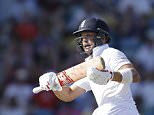 England's Jonathan Trott eyes the ball after playing a shot from the bowling of West Indies' Shannon Gabriel during day two of their third Test match at the Kensington Oval in Bridgetown, Barbados, Saturday, May 2, 2015. (AP Photo/Ricardo Mazalan)