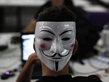 """A man wearing a Guy Fawkes mask surfs the web during a """"Campus Party"""" Internet users gathering in Sao Paulo January 30, 2013. Campus Party is an annual week-long, 24-hour technology festival that gathers around 8000 hackers, developers, gamers and computer geeks from around the world. REUTERS/Nacho Doce (BRAZIL - Tags: SOCIETY SCIENCE TECHNOLOGY BUSINESS TELECOMS) - RTR3D5WI"""