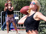 EXCLUSIVE TO INF.\nMay 3, 2015: Britney Spears and beau Charlie Ebersol head to the beach in Malibu, California to meet up with her family after attending her son's football match in Calabasas. The 33-year-old singer seemed fine as she ditched the brace and enjoyed throwing football at the beach. Britney recently had an accident while performing on stage in Las Vegas and was seen hobbling with an ankle brace.  After some fun at the beach, they drive in Charlie's 1980 Marathon Checker to Napa Tavern in Thousand Oaks for lunch.\nPictured here: Britney Spears\nMandatory Credit: Lazic/Chiva/INFphoto.com\nRef: infusla-257/276