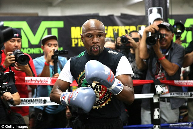 Mayweather loosens up before he takes part in a training session at the Mayweather Boxing Club