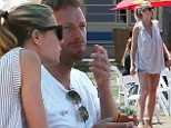 Exclusive. Coleman-Rayner. Los Angeles, May 3, 2015\nFriendly exes Gwyneth Paltrow and Chris Martin enjoy a cozy afternoon together in sunny Los Angeles. The Oscar winner flaunted her toned legs and munched on burgers with Chris, whose reported girlfriend Jennifer Lawrence is currently 3,000 miles away in New York City.\nCREDIT LINE MUST READ: Coleman-Rayner\n
