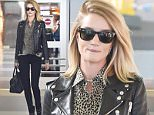 Rosie Huntington arrives at JFK airport in NYC.\n\nPictured: Reese Witherspoon\nRef: SPL1016053  030515  \nPicture by: Ron Asadorian / Splash News\n\nSplash News and Pictures\nLos Angeles: 310-821-2666\nNew York: 212-619-2666\nLondon: 870-934-2666\nphotodesk@splashnews.com\n