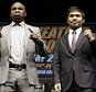 ADVANCE FOR WEEKEND EDITIONS, APRIL 25-26 - FILE - In this March 11, 2015, file photo, boxers Floyd Mayweather Jr., left, and Manny Pacquiao, of the Philippines, pose for photos after a news conference in Los Angeles. This is not Hagler-Hearns or Tyson vs. Anyone. Floyd Mayweather Jr. is the greatest defensive boxer in history, and Manny Pacquiao hasn't shown knockout power in a while. Expect this fight to go to the scorecards. (AP Photo/Jae C. Hong, File)