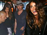UK CLIENTS MUST CREDIT: AKM-GSI ONLY EXCLUSIVE: Newlyweds Ian Somerhalder and Nikki Reed stopped by the trendy Antiquarius Restaurant in Rio de Janeiro with friends Paul Wesley and Phoebe Tonkin, the group had to walk through a frenzy of loyal fans that just wanted to get a quick glimpse of the stars.  Pictured: Ian Somerhalder and Nikki Reed Ref: SPL1016143  020515   EXCLUSIVE Picture by: AKM-GSI / Splash News