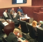 FILE - In this image taken from Colorado Judicial Department video, Colorado theater shooter James Holmes, left rear in light-colored shirt, watches during testimony by witness Derick Spruel, upper right, on the second day of his trial in Centennial, Colo., Monday, April 27, 2015. Standing at left is prosecutor Lisa Teesch-Maguire. Defense attorneys have urged jurors not to let emotions sway them, but with weeks of harrowing testimony still to come, experts say James Holmes¿ lawyers will have a difficult time convincing jurors to put sympathy behind them as they decide whether he was legally insane when he killed 12 people and injured 70 others in July 2012. (Colorado Judicial Department via AP, Pool, File)