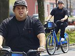 EXCLUSIVE: Jonah Hill spotted enjoying the spring weather while riding a Citi Bike on the West Side Highway bicycle path in NYC.  Pictured: Jonah Hill Ref: SPL1016923  040515   EXCLUSIVE Picture by: J. Webber / Splash News  Splash News and Pictures Los Angeles: 310-821-2666 New York: 212-619-2666 London: 870-934-2666 photodesk@splashnews.com