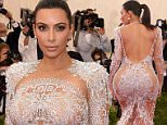 """NEW YORK, NY - MAY 04:  Kim Kardashian West and Kanye West  attend the """"China: Through The Looking Glass"""" Costume Institute Benefit Gala at Metropolitan Museum of Art on May 4, 2015 in New York City.  (Photo by Kevin Mazur/WireImage)"""