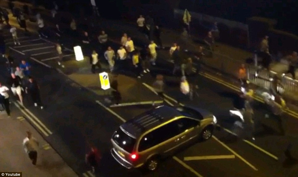 Reclaiming the streets: The group made their way through Enfield flanked by police officers during the late night patrol