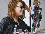 UK CLIENTS MUST CREDIT: AKM-GSI ONLY EXCLUSIVE: Actress Emma Stone exits a local gym with messy hair after a Monday afternoon workout session in Beverly Hills, CA. The 26-year-old actress is rumored to be starring in an upcoming movie musical with Ryan Gosling named 'La La Land,' about Sebastian (Gosling) and Mia (Stone), who are drawn together by their common desire to do what they love. But as success mounts they are faced with decisions that begin to fray the fragile fabric of their love affair, and the dreams they worked so hard to maintain in each other threaten to rip them apart.  Pictured: Emma Stone Ref: SPL1016839  040515   EXCLUSIVE Picture by: AKM-GSI / Splash News