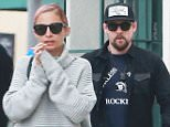 Picture Shows: Joel Madden  May 05, 2015\n \n With divorce 'imminent' according to sources, troubled couple Joel Madden and Nicole Richie show very public signs of discord after a brief meeting at California Pizza Kitchen in Westwood, California. The couple arrived in separate cars to the restaurant, where they met with an unidentified woman (not shown). After 40 minutes, Nicole exited walking several feet ahead of Joel, wringing her hands. She got into her car and revved it up immediately while a beleaguered Madden, who is still wearing his wedding ring, leaned through the window to say goodbye. The two spoke for a few minutes before exchanging a frosty goodbye handshake. Richie then walked slowly to his car, parked around the street. The couple's strained interaction seems to support the rumors that the two are in the process of ending their 5 year marriage. \n \n Exclusive All Rounder\n UK RIGHTS ONLY\n Pictures by : FameFlynet UK © 2015\n Tel : +44 (0)20 3551 5049\n Email : info@f