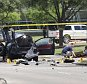 Local police and FBI investigators collect evidence, including a rifle, where two gunmen were shot dead after their bodies were removed in Garland, Texas May 4, 2015. Texas police shot dead two gunmen who opened fire on Sunday outside an exhibit of caricatures of the Prophet Mohammad that was organized by a group described as anti-Islamic and billed as a free-speech event. REUTERS/Laura Buckman      TPX IMAGES OF THE DAY