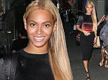 Beyonce Knowles looked amazing, stepping out in New York city.  The popstar carried a red and white handbag, in a red and black outfit, with honey-colored locks, on Friday, May 8, 2015   X17online.com