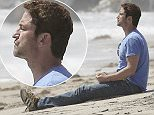 EXCLUSIVE TO INF. May 8, 2015: Gerard Butler gets Starbucks before heading off for meditation near a beach rock sculpture and a visit to the artist,  Malibu, CA. Mandatory Credit: SAA/Borisio Ref.: infusla-277/302