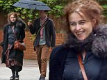 MUST BYLINE: EROTEME.CO.UK\nHelena Bonham-Carter is all smiles as she enjoys a stroll in the rain with an unknown man.  The actress who split from her husband Tim Burton last year could have found herself a new man.\nEXCLUSIVE    May 8,  2015\nJob: 150508L4    London, England\nEROTEME.CO.UK\n44 207 431 1598\nRef:  341629\n