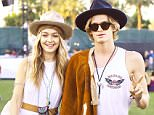 Gigi Hadid and boyfriend Cody Simpson were spotted enjoying themselves at Coachella in Indio, CA. The couple posed for the cameras with Gigi sticking her tongue out and Cody throwing a peace sign.....Pictured: Gigi Hadid, Cody Simpson..Ref: SPL1000559  160415  ..Picture by: Sharpshooter Images....Splash News and Pictures..Los Angeles: 310-821-2666..New York: 212-619-2666..London: 870-934-2666..photodesk@splashnews.com..