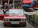 Jeff Moore 07870209766 09/05/15 FOR SUNDAY PAPERS - Jeremy Clarkson does a roly poly from a car during London filming with Richard Hammond and  James May for their upcoming live arena tour.