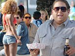 Jonah Hill filming a scene on set of Arms and Dudes in Miami. The portly actor was seen carrying cheese fries as he acted in a scene with actor Miles Teller. The actors walked and were seen hitting on beach bikini girls in the scene.\n\nPictured: Jonah Hill and Miles Teller\nRef: SPL1005390  080515  \nPicture by: Jason Winslow / Splash News\n\nSplash News and Pictures\nLos Angeles: 310-821-2666\nNew York: 212-619-2666\nLondon: 870-934-2666\nphotodesk@splashnews.com\n