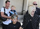 Gwen Stefani and Gavin were spotted at LAX with their three boys, Kingston, Zuma and Apollo.  The pop star traveled casually in jeans and a cartigan just in time for mothers day May 9, 2015   X17online.com