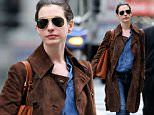Actress, Anne Hathaway, wearing a brown suede jacket, denim shirt, jeans and gray ankle boots walks home after her matinee performance of 'Grounded' at Public Theater in New York City.\n\nPictured: Anne Hathaway\nRef: SPL1021571  090515  \nPicture by: Christopher Peterson/Splash News\n\nSplash News and Pictures\nLos Angeles: 310-821-2666\nNew York: 212-619-2666\nLondon: 870-934-2666\nphotodesk@splashnews.com\n