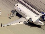 A plane with dozens of passengers landed safely at LAX Monday despite being unable to deploy some of its landing gear, officials said.  The SkyWest Airlines plane with 43 people aboard reported ?problems? as it approached the airport to land at about 8:30 a.m., LAX spokeswoman Katherine Alvarado confirmed.  The jet was unable to extend its left main landing gear before landing on runway 24L, Ian Gregor with the Federal Aviation Administration said.  The plane came to a stop with the landing gear still retracted and was immediately surrounded by emergency personnel, aerial video from Sky5 showed.  Passengers exiting the plane were being placed on busses, according to Erik Scott of the Los Angeles Fire Department.  The captain of the plane did not report any injuries, according to Gregor.