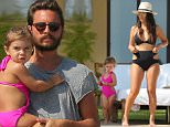 EXCLUSIVE: **PREMIUM EXCLUSIVE RATES ** Kourtney Kardashian has fun pool day with Penelope and Scott Disick at Joe Francis' Casa Aramara in Punta Mita, Mexico. Kourtney wore a stylish hat and sunglasses as she showed off her swimsuit ready body for the first time since giving birth to Reign Disick in Decemember. Scott Disick joined Kourtney by the pool as he read an architecture magazine and played with daughter Penelope who wore a bright pink one piece. Kourtney gave her daughther some gummy snacks as she helped to open them for her to enjoy by the pool. Pictures taken Saturday 9th May 2015\n\nPictured: Kourtney Kardashian, Scott Disick, Penelope Disick\nRef: SPL1022833  110515   EXCLUSIVE\nPicture by: Brian Prahl / Splash News\n\nSplash News and Pictures\nLos Angeles:310-821-2666\nNew York:212-619-2666\nLondon:870-934-2666\nphotodesk@splashnews.com\n
