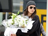 9.MAY.2015 - LONDON - UK * EXCLUSIVE ALL ROUND PICTURES * *** STRICTLY NOT AVAILABLE FOR MAIL ONLINE AND ANY ONLINE SUBSCRIPTION DEALS UNLESS FEE AGREED PRIOR TO USAGE*** ** NOT AVAILABLE FOR FRANCE ** SUPERMODEL AND BRADLEY COOPER'S NEW GIRLFRIEND IRINA SHAYK IS MET BY AN ASSISTANT AT HEATHROW WITH A HUGE BOUQUET OF FLOWERS...COULD THEY BE FROM BRADLEY? IRINA IS IN LONDON WORKING WITH AN UNKNOWN COMPANY FILMING AT THE VICTORIA AND ALBERT MUSEUM. CHINESE TAKEAWAY FOOD WAS SEEN BEING DELIVERED TO THE BACK DOOR PART WAY THROUGH THE EVENING BYLINE MUST READ : XPOSUREPHOTOS.COM ***UK CLIENTS - PICTURES CONTAINING CHILDREN PLEASE PIXELATE FACE PRIOR TO PUBLICATION *** **UK CLIENTS MUST CALL PRIOR TO TV OR ONLINE USAGE PLEASE TELEPHONE 0208 344 2007**