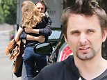 Please contact X17 before any use of these exclusive photos - x17@x17agency.com   Kate Hudson's ex, Matthew Bellamy hands out with a friend waiting for a pretty mystery girl who he gives a bog hug that doesn't look like Elle Evans who he is allegedly currently dating May 11, 2015 X17online.com