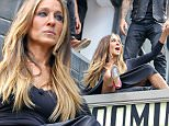 Sarah Jessica Parker spotted sitting on top of the Bloomingdale's sign while doing a photo shoot in New York City on May 11, 2015.\n\nPictured: Sarah Jessica Parker\nRef: SPL1023232  110515  \nPicture by: Felipe Ramales / Splash News\n\nSplash News and Pictures\nLos Angeles: 310-821-2666\nNew York: 212-619-2666\nLondon: 870-934-2666\nphotodesk@splashnews.com\n