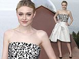 Actress Dakota Fanning arrives at the Dior Resort 2015 catwalk show presented in Cannes, southeastern France, Monday, May 11, 2015. (AP Photo/Lionel Cironneau)