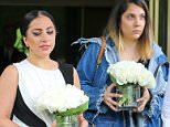 EXCLUSIVE: Lady Gaga and her sister, Natali Germanotta, spotted carrying a bouquet of roses for their mom, while leaving the singer's apartment building in New York City.  Pictured: Lady Gaga and Natali Germanotta Ref: SPL1022564  100515   EXCLUSIVE Picture by: Felipe Ramales / Splash News  Splash News and Pictures Los Angeles: 310-821-2666 New York: 212-619-2666 London: 870-934-2666 photodesk@splashnews.com