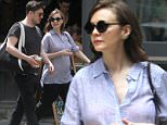 EXCLUSIVE: Carey Mulligan appears to show a bump in her belly as she walks with rocker husband Marcus Mumford, fueling rumors they are expecting their first child.\nCarey, wearing a loose-fitting blue shirt, walked with her Mumford & Sons lead singer husband through trendy SoHo in New York.\nAmerican media reports claim the actress is expecting her first child, and a bulge in her midriff as she walked adds to the rumors. The couple went shopping and then met friends for lunch.\n\nPictured: Carey Mulligan and Marcus Mumford\nRef: SPL1023685  120515   EXCLUSIVE\nPicture by: Lee Brown / Splash News\n\nSplash News and Pictures\nLos Angeles: 310-821-2666\nNew York: 212-619-2666\nLondon: 870-934-2666\nphotodesk@splashnews.com\n