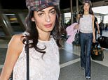 11.MAY.2015 - LOS ANGELES  - USA\n*** EXCLUSIVE ALL ROUND PICTURES WITH DOUBLE SPACE RATES FOR GERMAN CLIENTS *\nGEORGE CLOONEY'S WIFE AMAL CLOONEY LOOKING ELEGANTE WEARING A TARTAN HAT AT LOS ANGELES INTERNATIONAL AIRPORT (LAX). SHE WAS WEARING JEANS WITH A WHITE TOP AND SILVER SHOES AS SHE STROLLED THROUGH THE AIRPORT PULLING HER LUGGAGE.\nBYLINE MUST READ : XPOSUREPHOTOS.COM\n***UK CLIENTS - PICTURES CONTAINING CHILDREN PLEASE PIXELATE FACE PRIOR TO PUBLICATION ***\n**UK CLIENTS MUST CALL PRIOR TO TV OR ONLINE USAGE PLEASE TELEPHONE  44 208 344 2007**