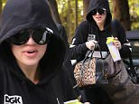 Khloe Kardashian keeps low profile with a hood and shades while visiting sister Kendall Jenner at her apartment. May 11, 2015 X17online.com