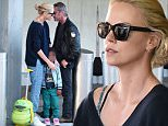 10 May 2015 - NEW YORK - USA  CHARLIZE THERON WITH SON JACKSON AND SEAN PENN ARRIVE AT JFK AIRPORT IN NYC.   BYLINE MUST READ : XPOSUREPHOTOS.COM  ***UK CLIENTS - PICTURES CONTAINING CHILDREN PLEASE PIXELATE FACE PRIOR TO PUBLICATION ***  **UK CLIENTS MUST CALL PRIOR TO TV OR ONLINE USAGE PLEASE TELEPHONE  44 208 344 2007 ***