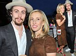 WEST HOLLYWOOD, CA - MAY 12: (L-R) Filmmaker , actor Aaron Taylor-Johnson and filmmaker Liz Goldwyn attend an intimate dinner hosted by Charlotte Olympia Dellal and Liz Goldwyn at The Sunset Tower Hotel on May 12, 2015 in West Hollywood, California.  (Photo by Donato Sardella/Getty Images for Charlotte Olympia)