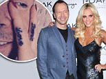 Mandatory Credit: Photo by KCR/REX_Shutterstock (4432856e).. Donnie Wahlberg, Jenny McCarthy.. Jenny McCarthy Hosts Valentine's Weekend at 1OAK Nightclub, Las Vegas, America - 13 Feb 2015.. ..