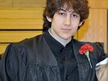 """Enterprise News and Pictures                                  22/4/13\nPic shows: Boston marathon bombing suspect Dzhokhar Tsarnaev in a graduation picture at the Cambridge Rindge and Latin School in Massachusetts. This picture was posted on Twitter by Robin Young, who added the caption: """" My beloved nephew on right(not in this cropped version), djohar tsarnaev on left, happy cambridge Rindge and Latin grads.heartbreaking."""" Fellow students reveal Tsarnaev calmy returned to his campus as if nothing had happened on April 16 and 17 after the bombings which killed three and injured more than 170 last Monday. Tsarnaev was finally arrested seriously wounded in his hiding place after he was discovered in a boat in the yard of a property at 67 Franklin Street in Watertown, Massachusetts, on Friday.\nTsarnaev was captured alive but wounded after hiding out in the boat. He fled after his older brother Tamerlan was killed in a shootout with police.\nTasarnaev's double life surprised his fellow c"""