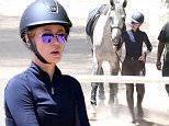"Picture Shows: Iggy Azalea  May 11, 2015.. .. Aussie rapper Iggy Azalea showed off her equestrian skills on Thursday as she went horseback riding in Los Angeles, California. Iggy's recent collaboration with Britney Spears, ""Pretty Girls"", was far from a smash hit and fell out of the iTunes Top 20 after five days. .. .. Non Exclusive.. UK RIGHTS ONLY.. .. Pictures by : FameFlynet UK © 2015.. Tel : +44 (0)20 3551 5049.. Email : info@fameflynet.uk.com"