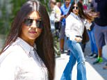 West Hollywood, CA - Kourtney Kardashian arrives at DASH in West Hollywood with Scott and Mason Disick to film a few scenes for KUWTK. Kourtney rocked flared denim jeans with platform heels and a white button up see-through top as she and her boys entered the store with cameras on them.\nAKM-GSI       May  12, 2015\nTo License These Photos, Please Contact :\nSteve Ginsburg\n(310) 505-8447\n(323) 423-9397\nsteve@akmgsi.com\nsales@akmgsi.com\nor\nMaria Buda\n(917) 242-1505\nmbuda@akmgsi.com\nginsburgspalyinc@gmail.com