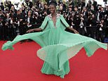 Mexican-Kenyan actress Lupita Nyong'o poses as she arrives for the opening ceremony of the 68th Cannes Film Festival in Cannes, southeastern France, on May 13, 2015.   AFP PHOTO / VALERY HACHEVALERY HACHE/AFP/Getty Images